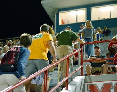 Commissioner Jim Hammontree climbs Heritage High School stadium