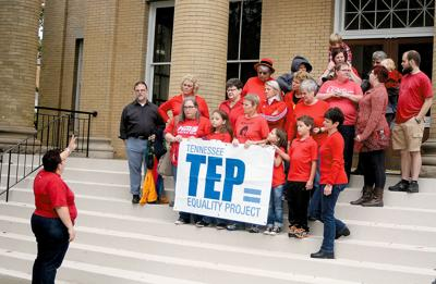 Gwen Schablik (left) talks to a group of citizens with the Tennessee Equality Project on the steps of the Blount County Courthouse Friday opposing anti same sex marriage resolution.
