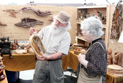 Mel Scroggins with Nature in Wood shows a wood wall hanging
