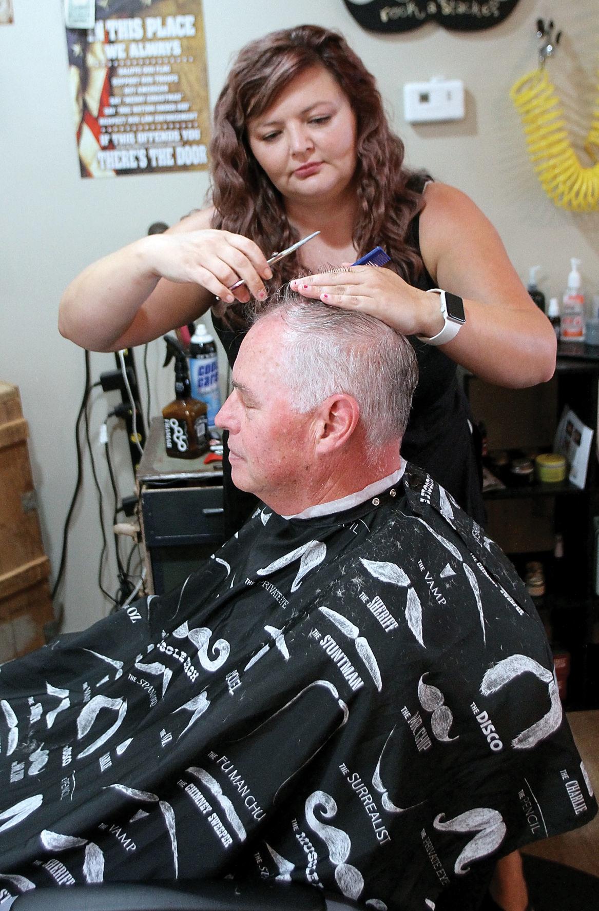 Nakitta Hancock cuts Charles Cunningham's hair