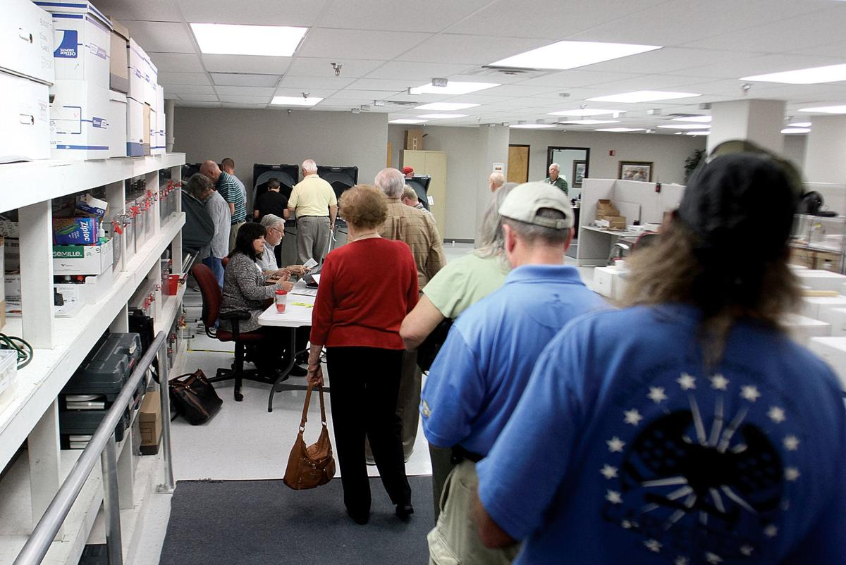 Voters line up to vote on the first day of early voting
