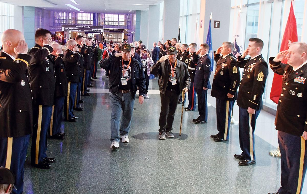 Veterans walked through an honor guard before departing for Washington D.C.