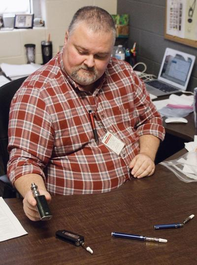 Alcoa High School Assistant Principal Tony Spears shows confiscated vaping devices