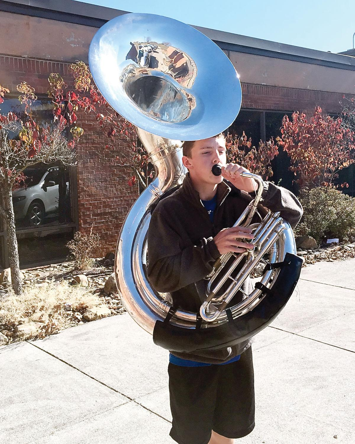 William Blount High School student Tommy Bond plays sousaphone with mouthpiece he printed