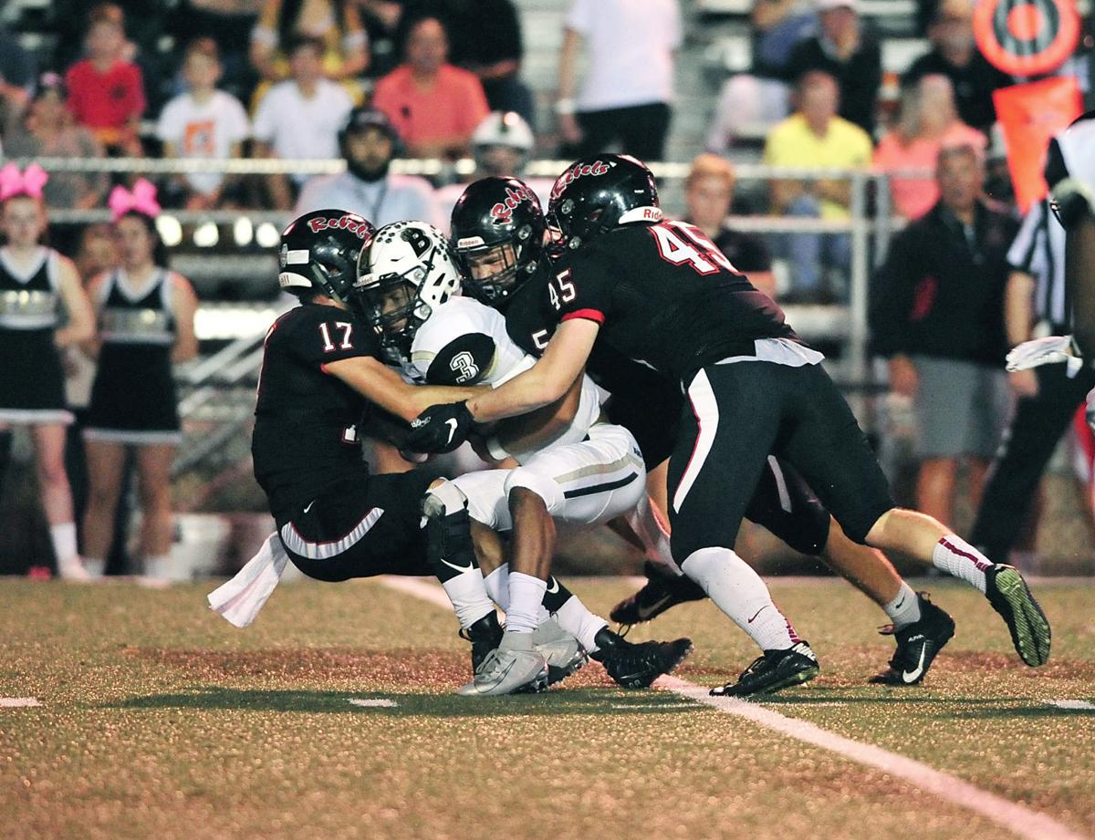 FOOTBALL: Maryville's Lou Burchfield, Colton Peek and Ethan Ensley vs Bradley Central