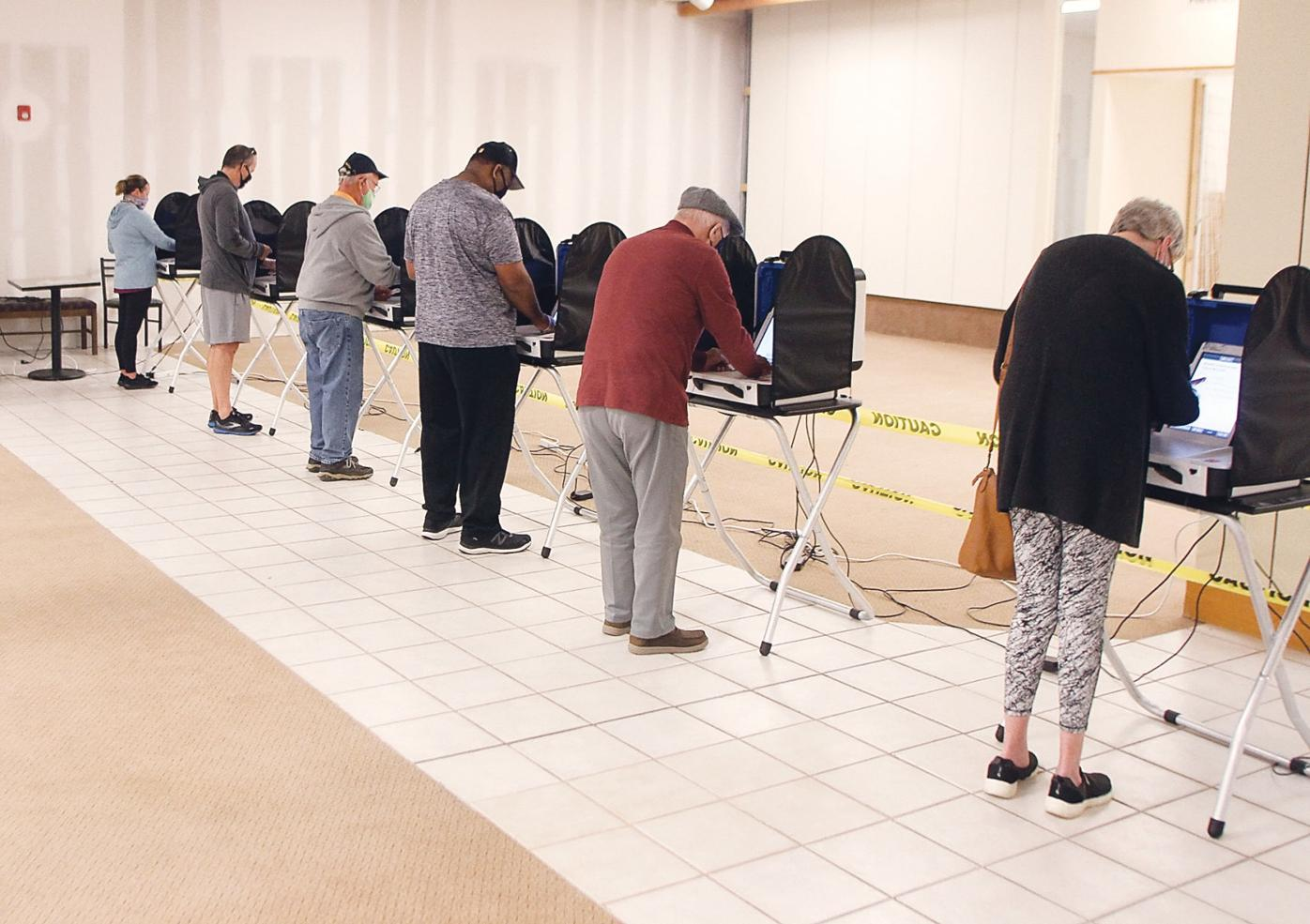 Voters cast their ballots at the Foothills Mall location