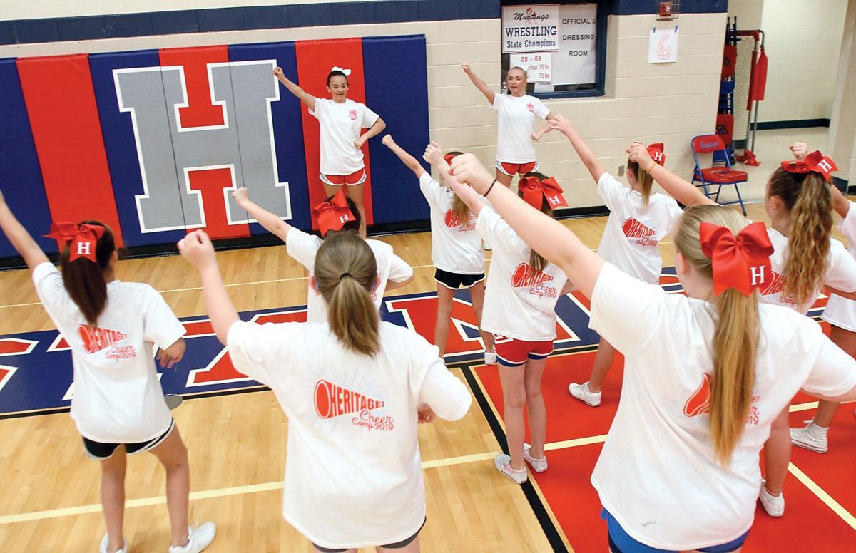Heritage High School cheerleaders Cadi Childers and Kaylee Bickett