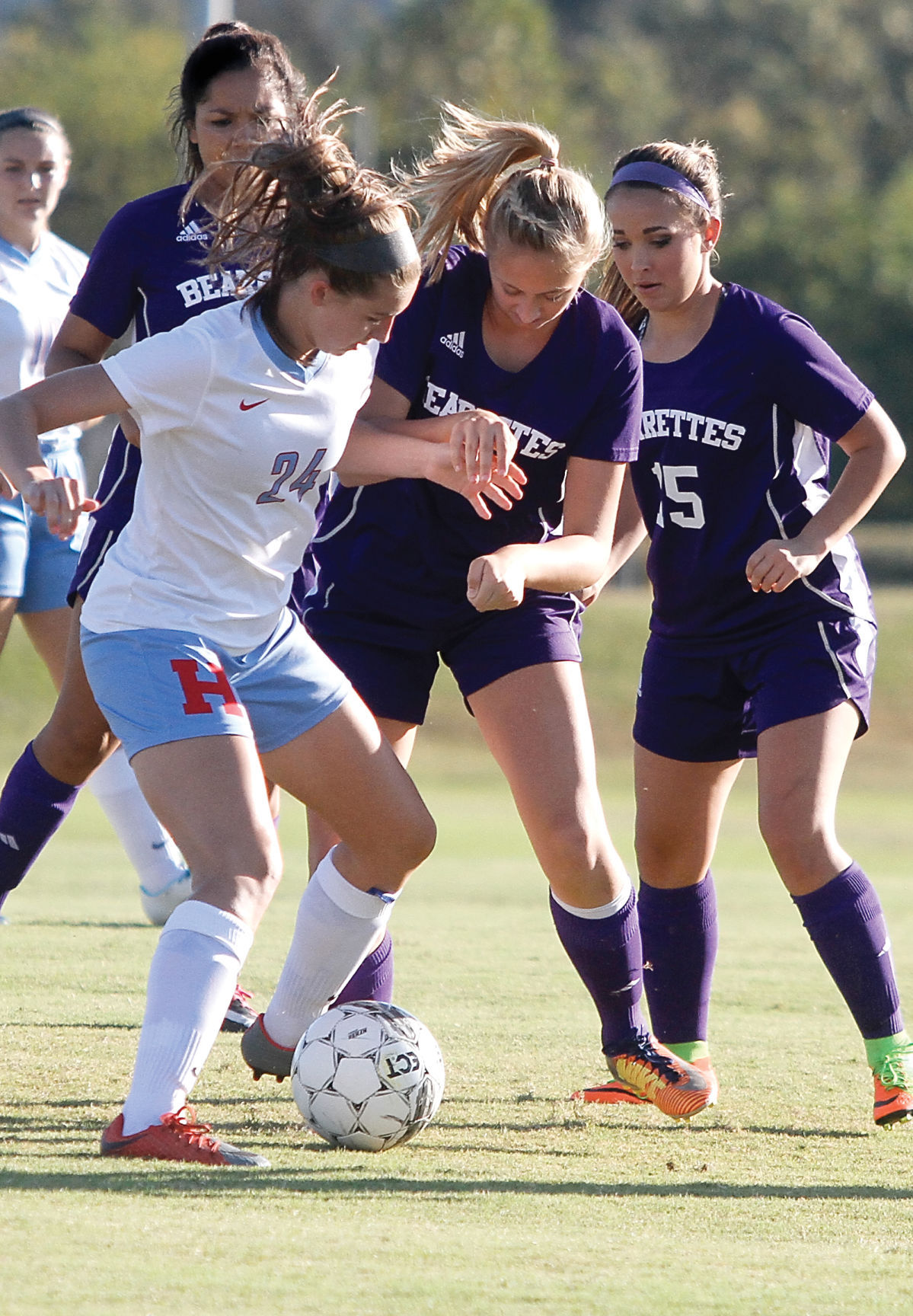 Kaitlin Burger attempts to protect the ball from the Sevier County defender