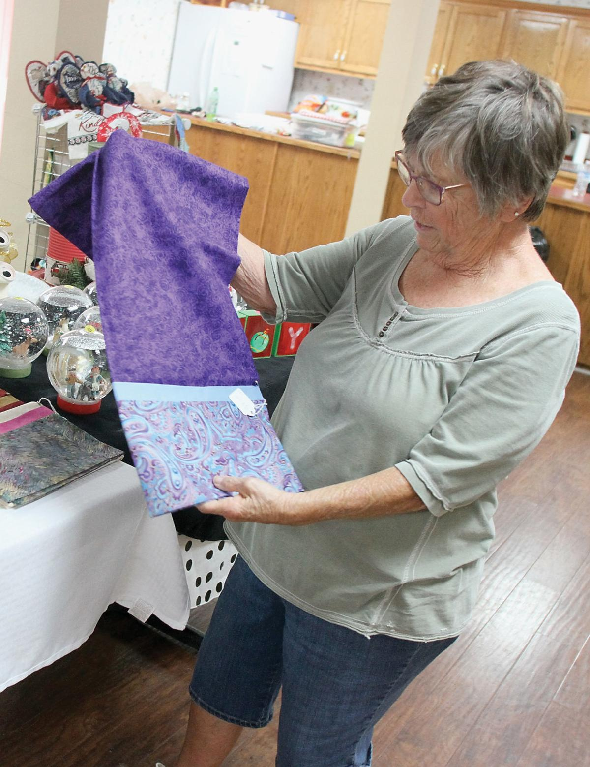 Joyce Thor shows pillowcase she made for Big Valley Resort's Fall Festival