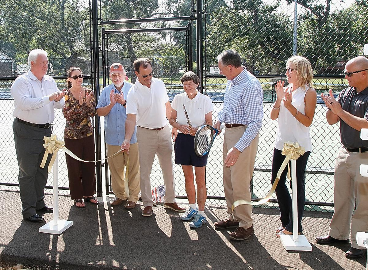 Caroline Haynes smiles after cutting the ribbon to the new tennis and pickleball courts