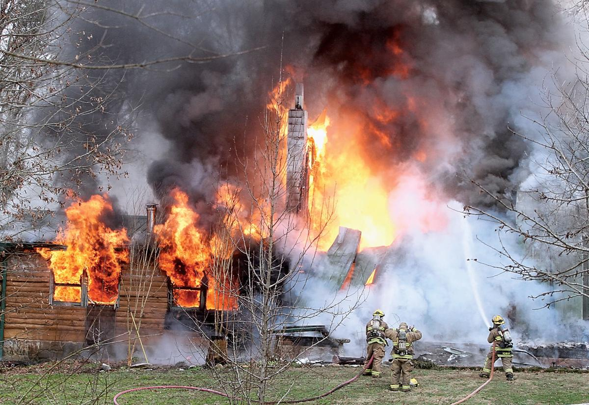 Blount County fire fighters battle a log cabin home fire on Reagan Mill Road