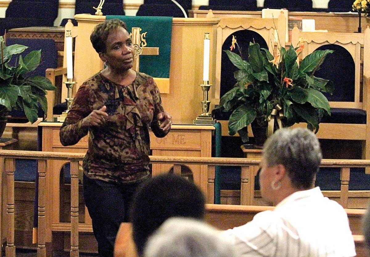 Willa Estell of St. Paul AME Church leads the Interfaith Prayer Service
