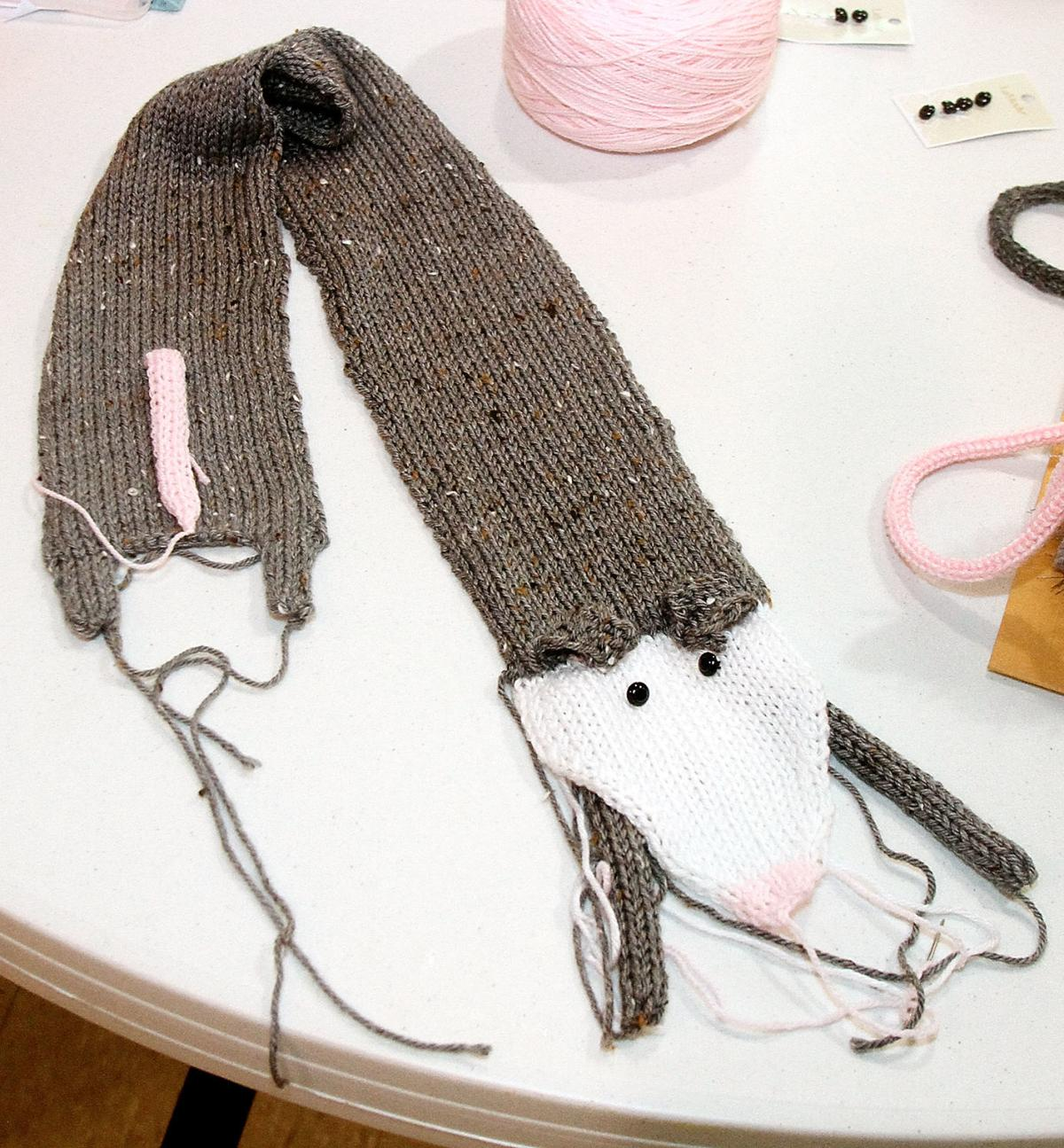 The Tennessee Valley Machine Knitters are knitting opossum scarves and purses