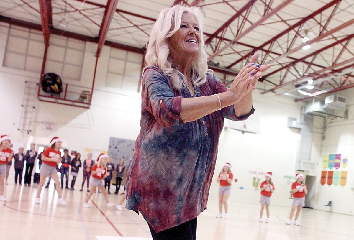 Geneva Ledford leads cheers at Walland Elementary School