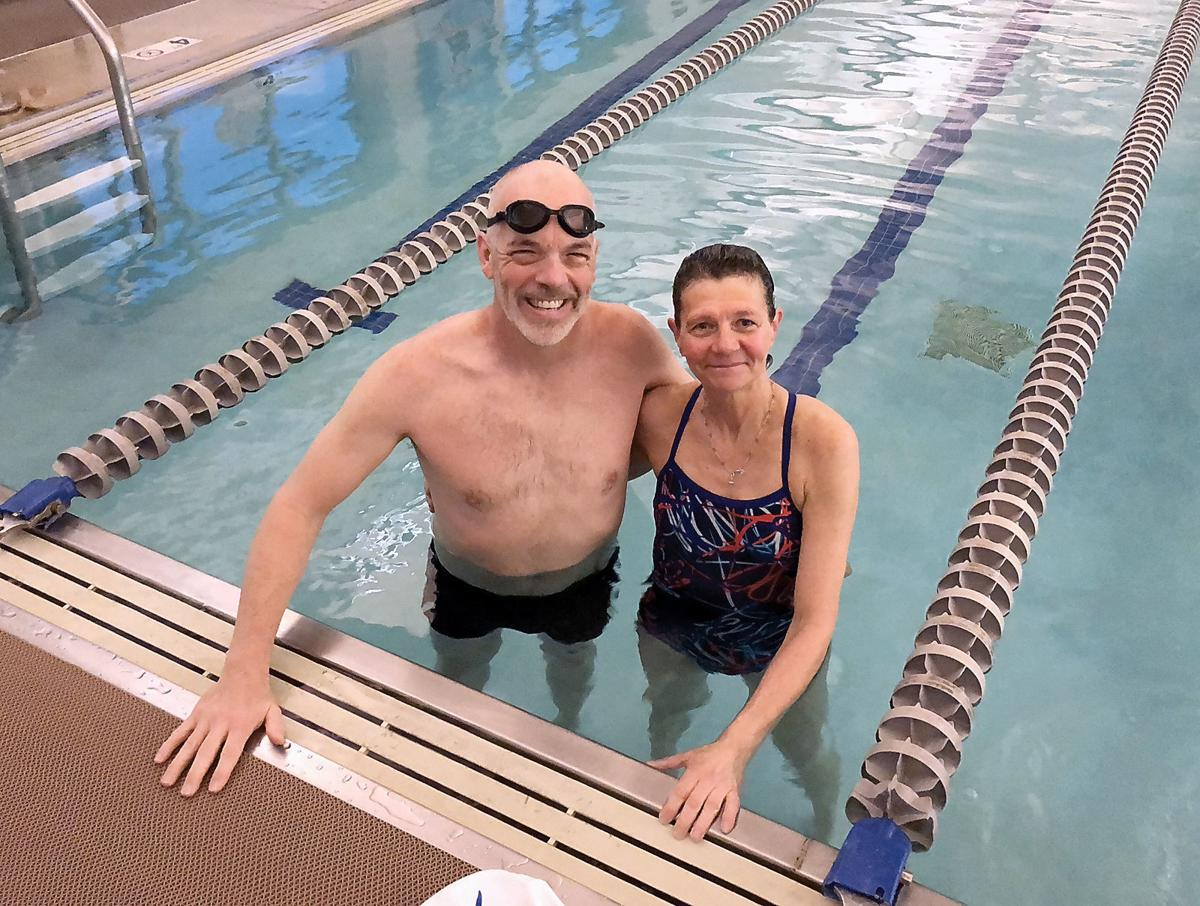 Phil Colclough with his swimming partner