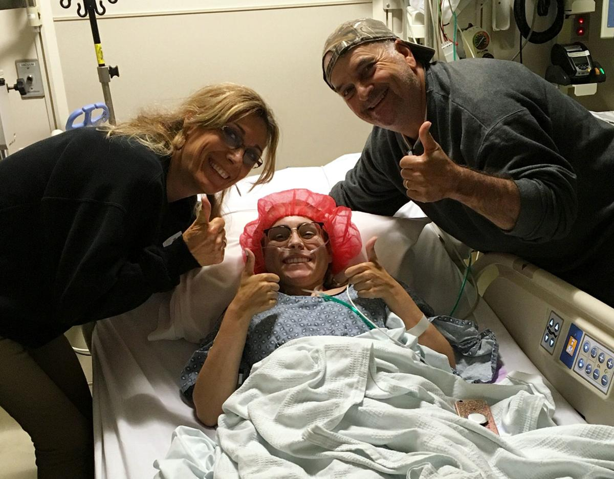 Kathryn Norris with her parents, Cristina and Al, at Duke University Medical Center