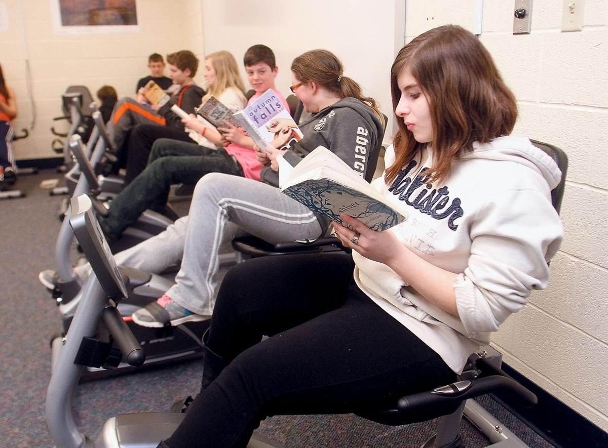 Carpenters Middle School students Halie Hudgens and Lexxus Woods study in the Pedal Power program
