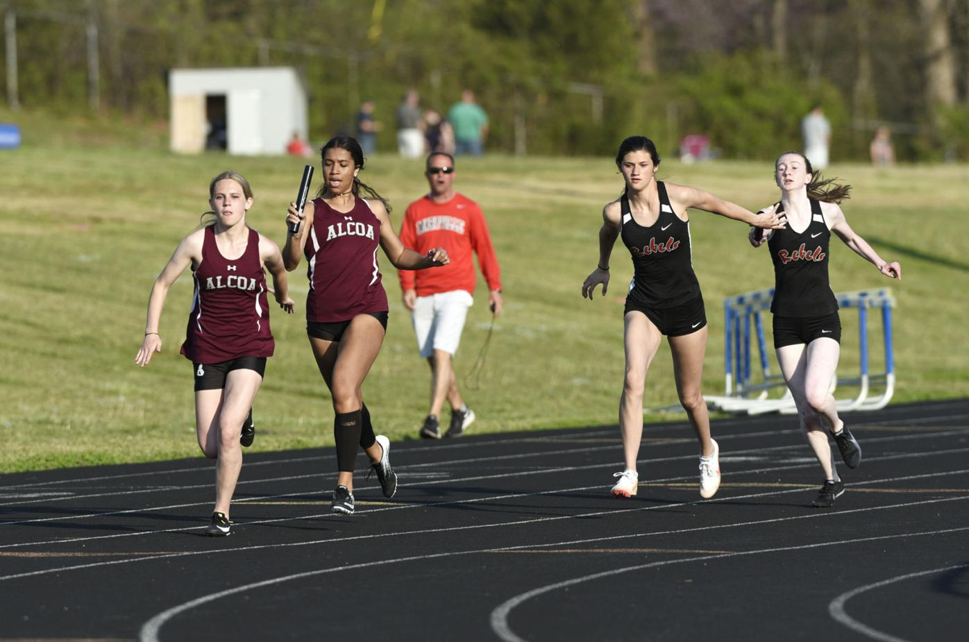 TRACK AND FIELD Alcoa's Olivia Baumann and Asia Cole Maryville's Kendall Whitehead and Jasmine Mayden