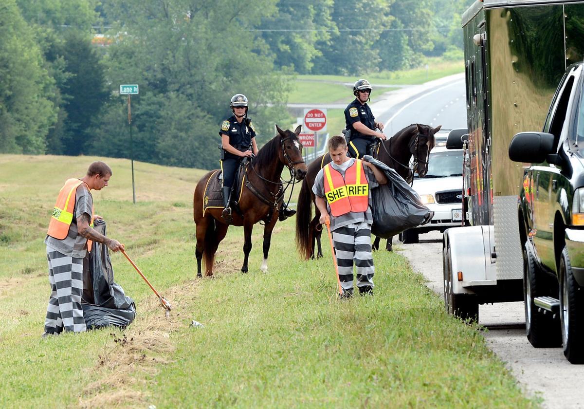 Inmates clean up trash on highway
