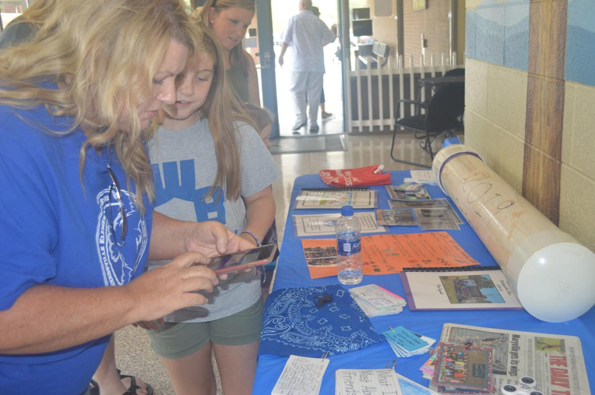 Hope and Grace Hines at Friendsville Elementary School's time capsule