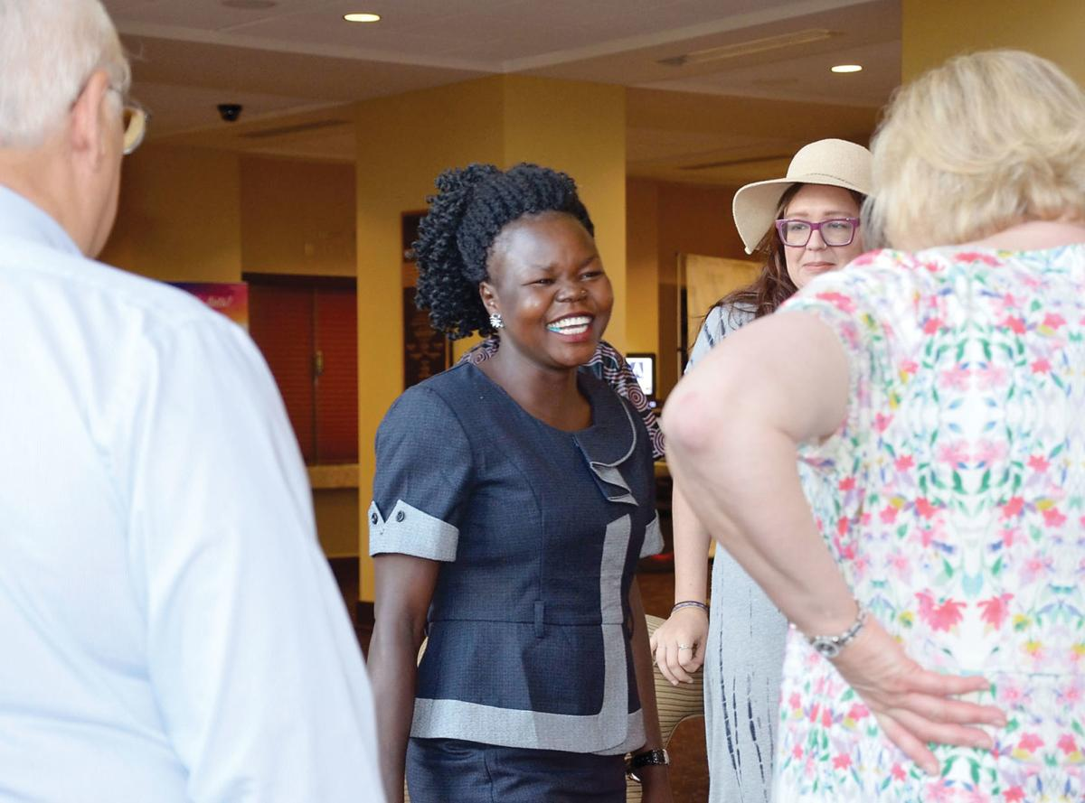 Betty Asha, center, greets AFRICA ELI executive director Anita Henderlight
