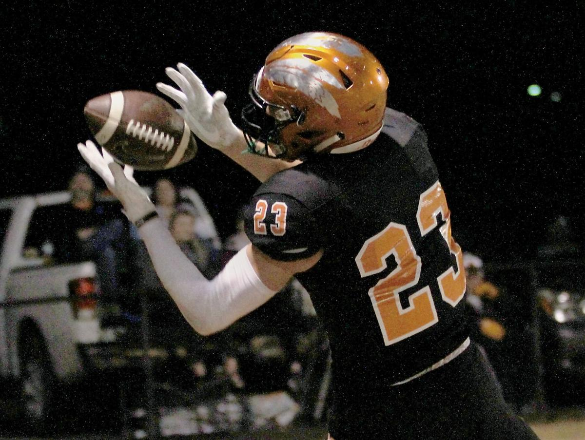 Greenback's Holden Willis pulls in a pass for a touchdown