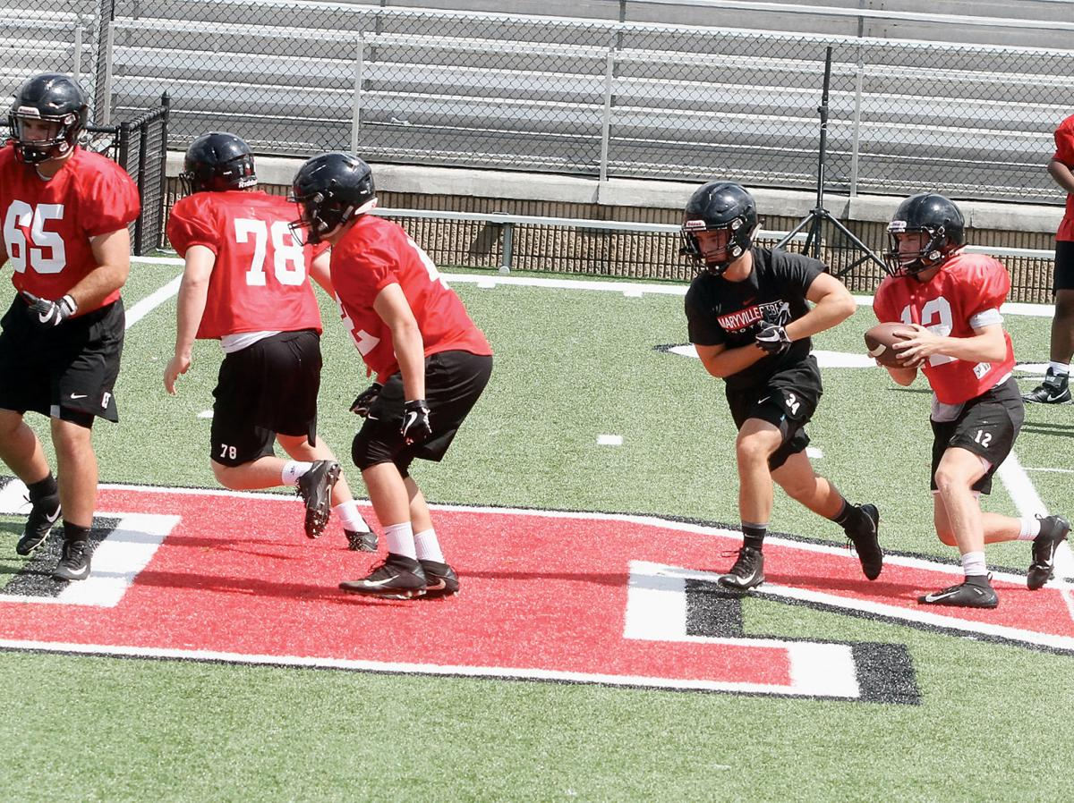 Maryville High School football players run through plays during the first day of practice