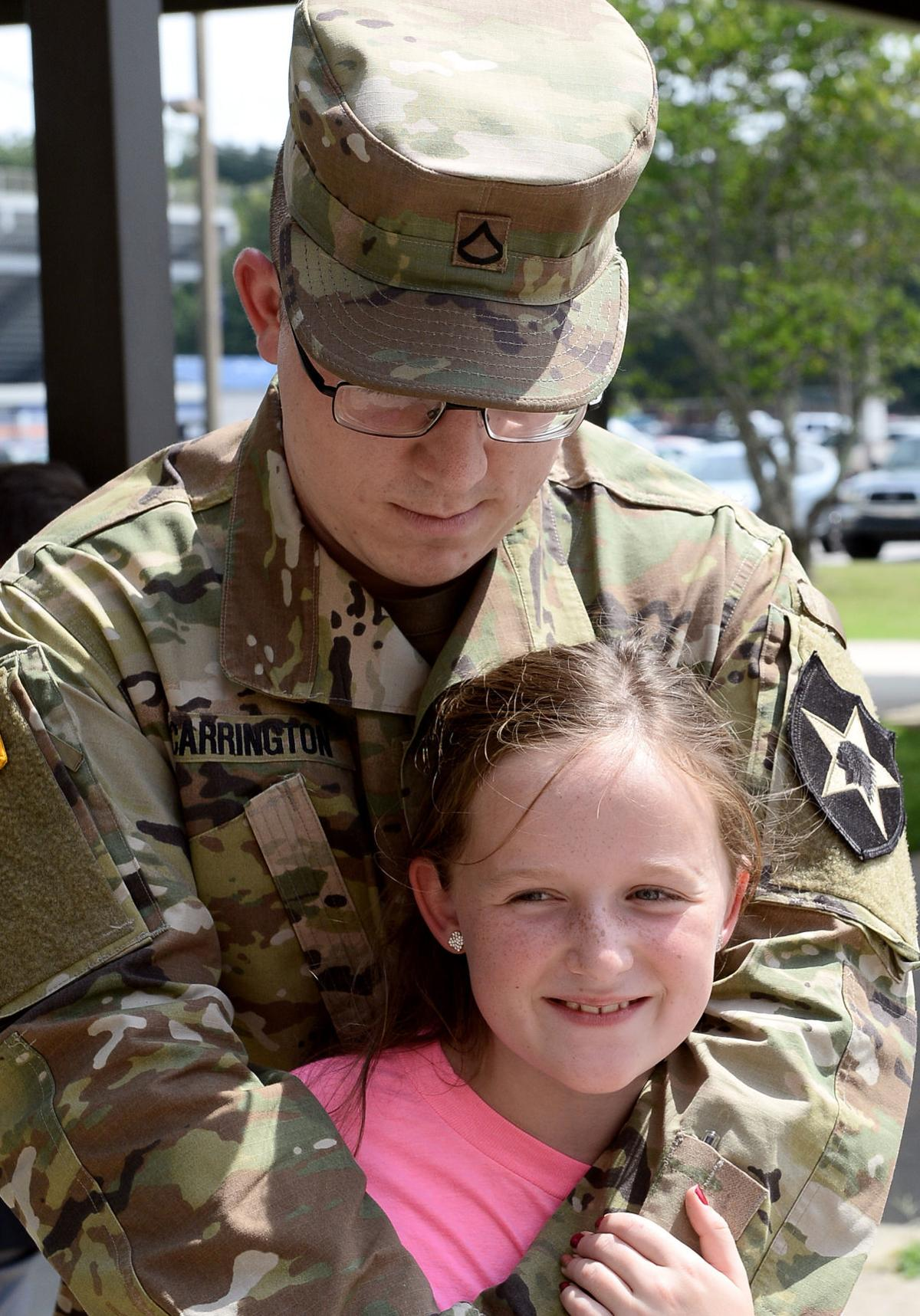 Pfc. Dakota Carrington with his sister, Tori