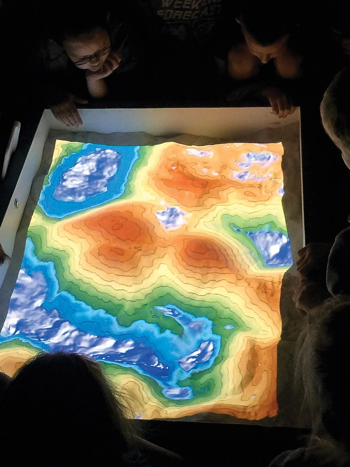 Augmented reality sandbox shows contour map in 3D at Walland Elementary
