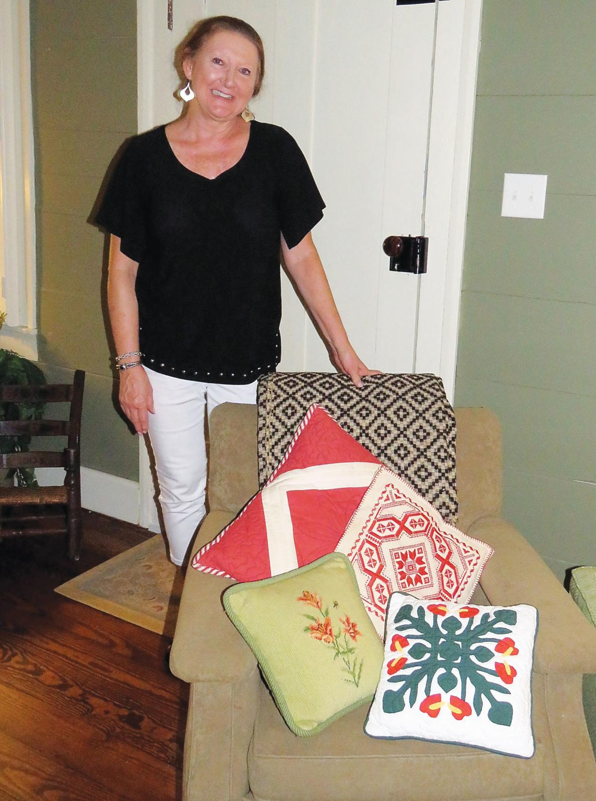 Cindy Benefield stands with an assortment of items