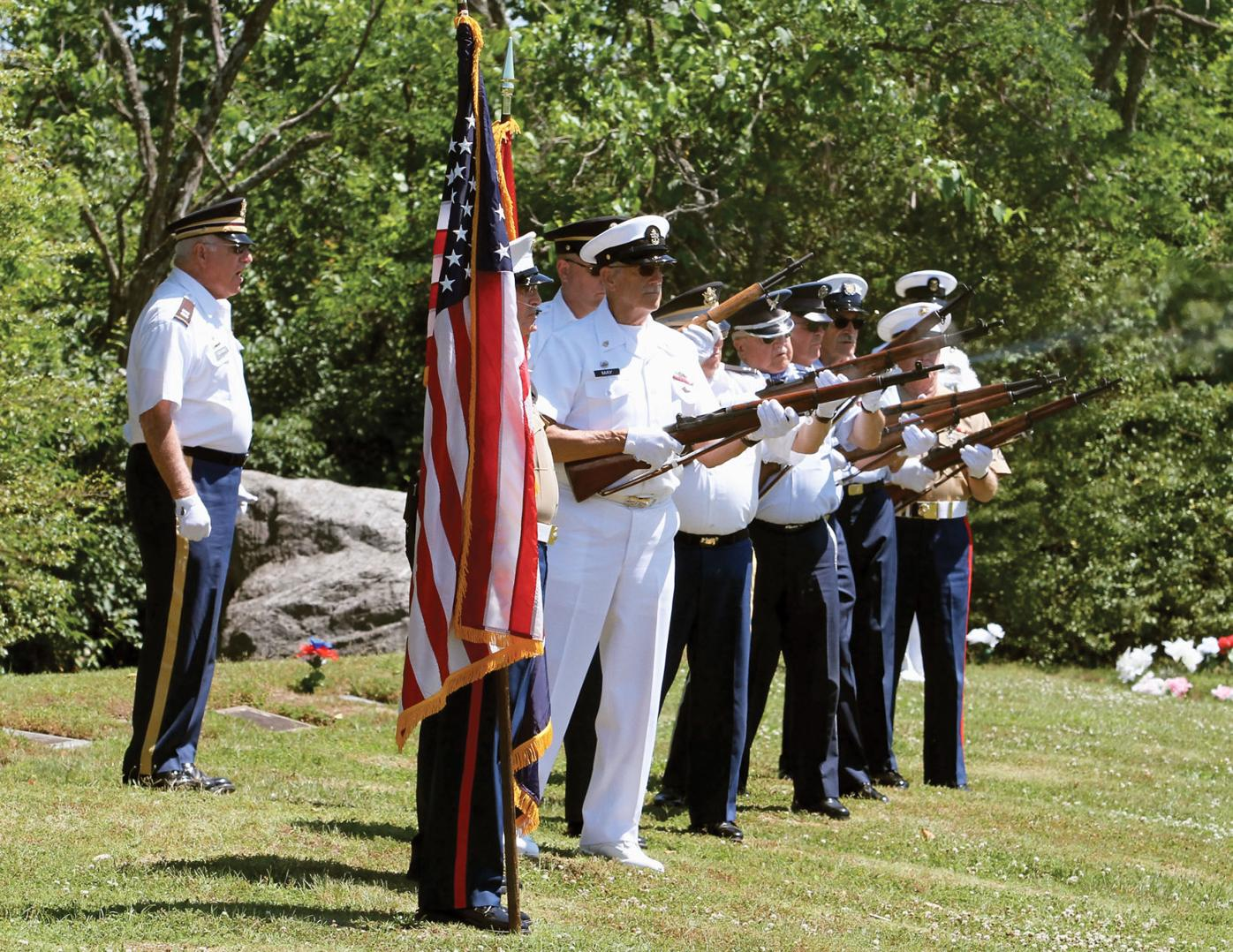 The East Tennessee Honor Guard fires a twenty-one gun salute