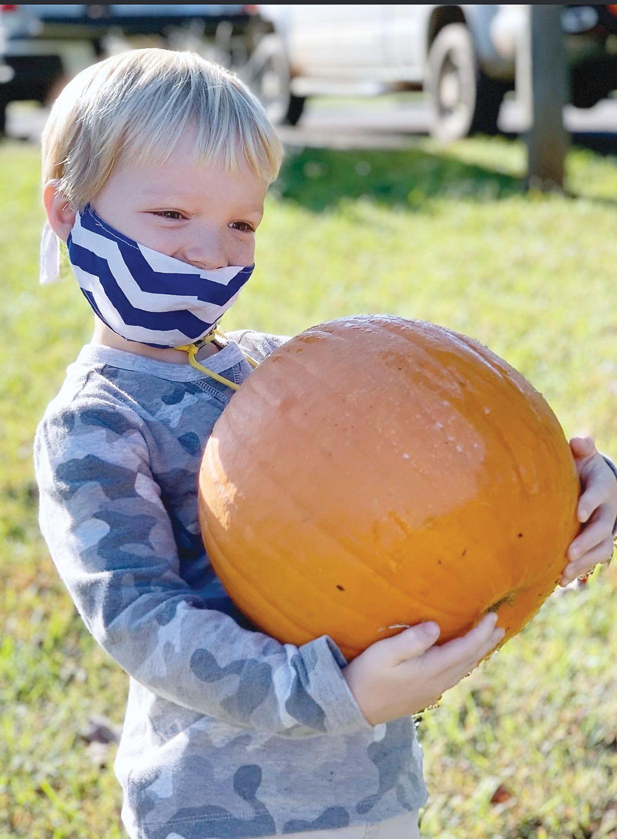 Middlesettlements Elementary kindergartner Eldon Greene with pumpkin