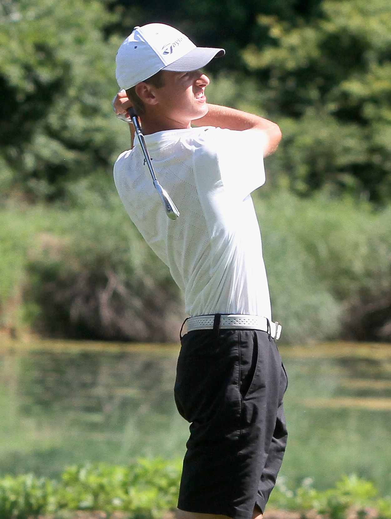 Bryce Beeler watches his tree shot down the fairway