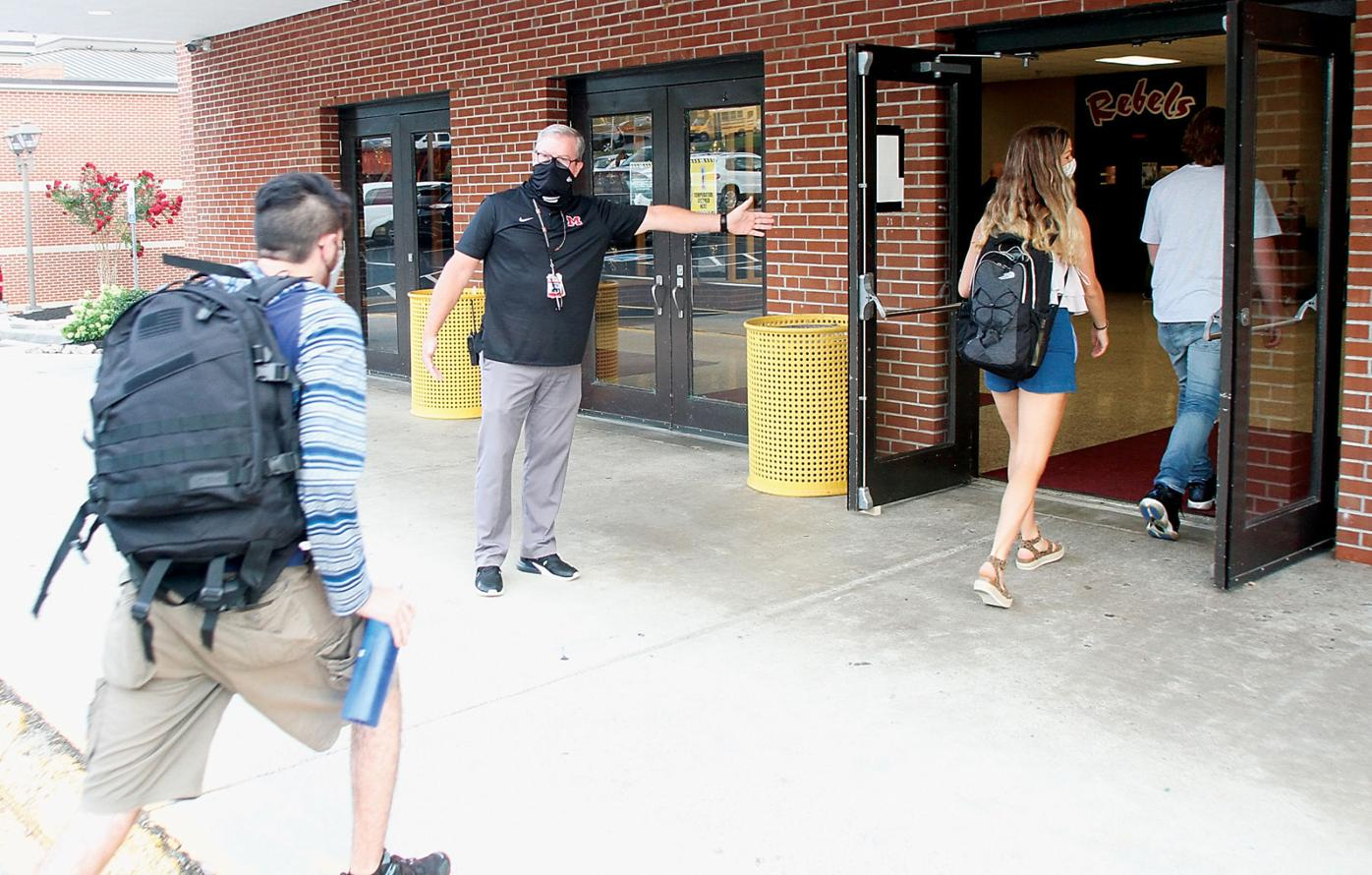 Maryville High School Assistant Principal Brett Coulter guides students on first day