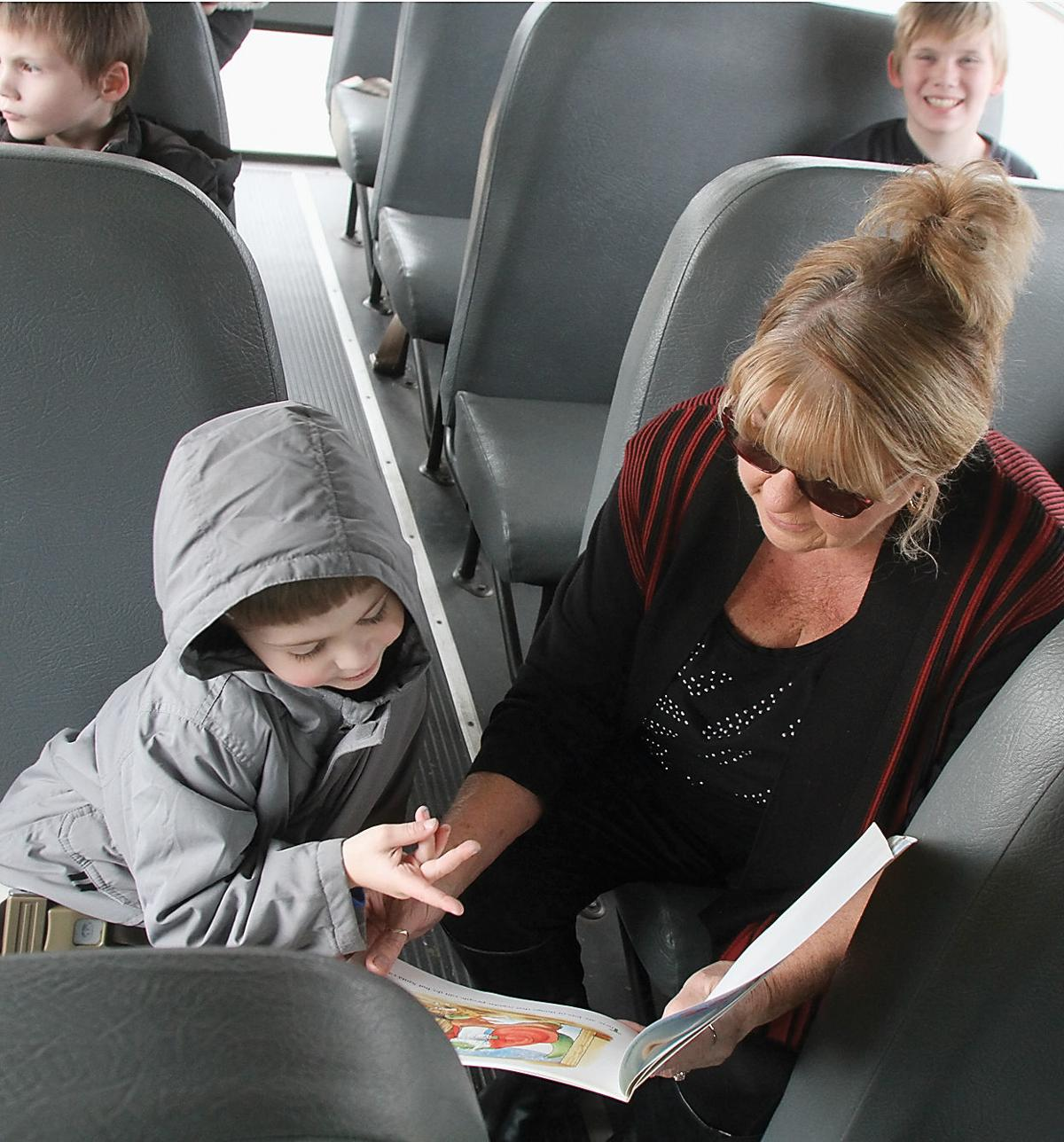Sandy Finchum reads to special education students on Blount County Schools bus