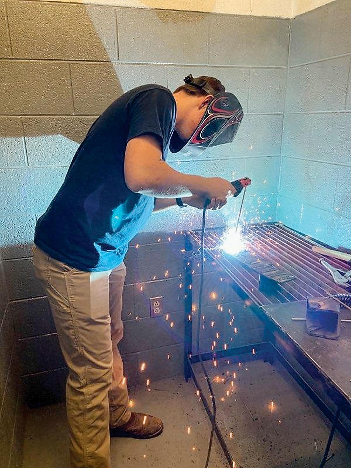 Chase Tilley performs a stick weld at the National FFA Convention