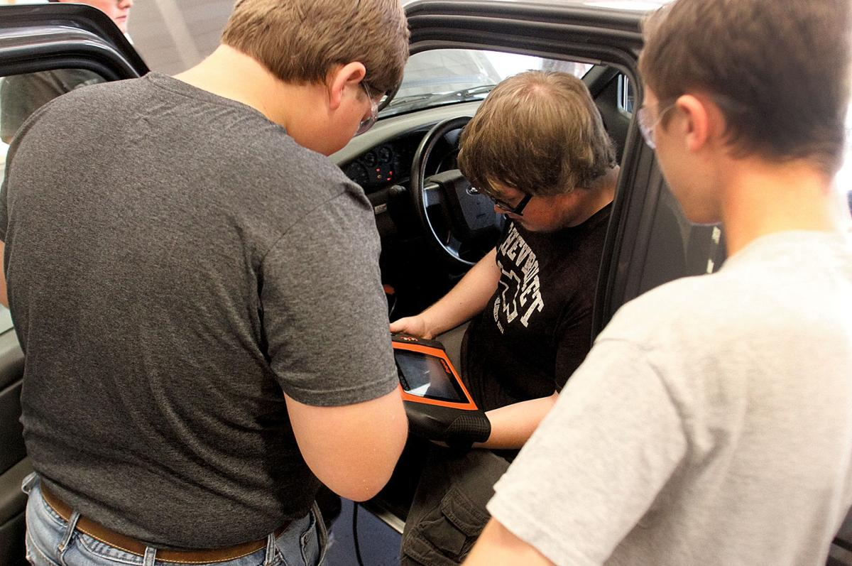 HHS students diagnose engine trouble during Top Wrench competition