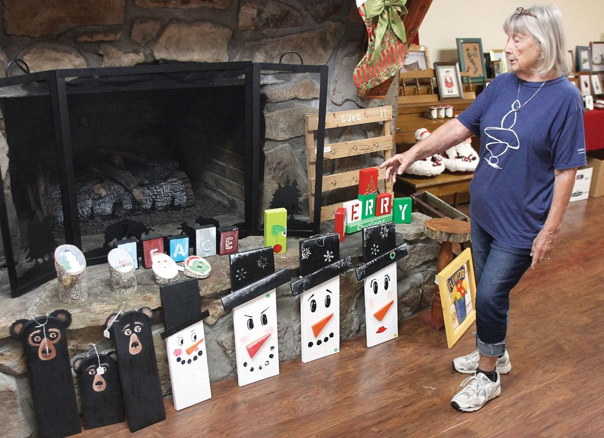 Jill Sears talks bout her wooden bears and snowmen for Big Valley Resort Fall Festival