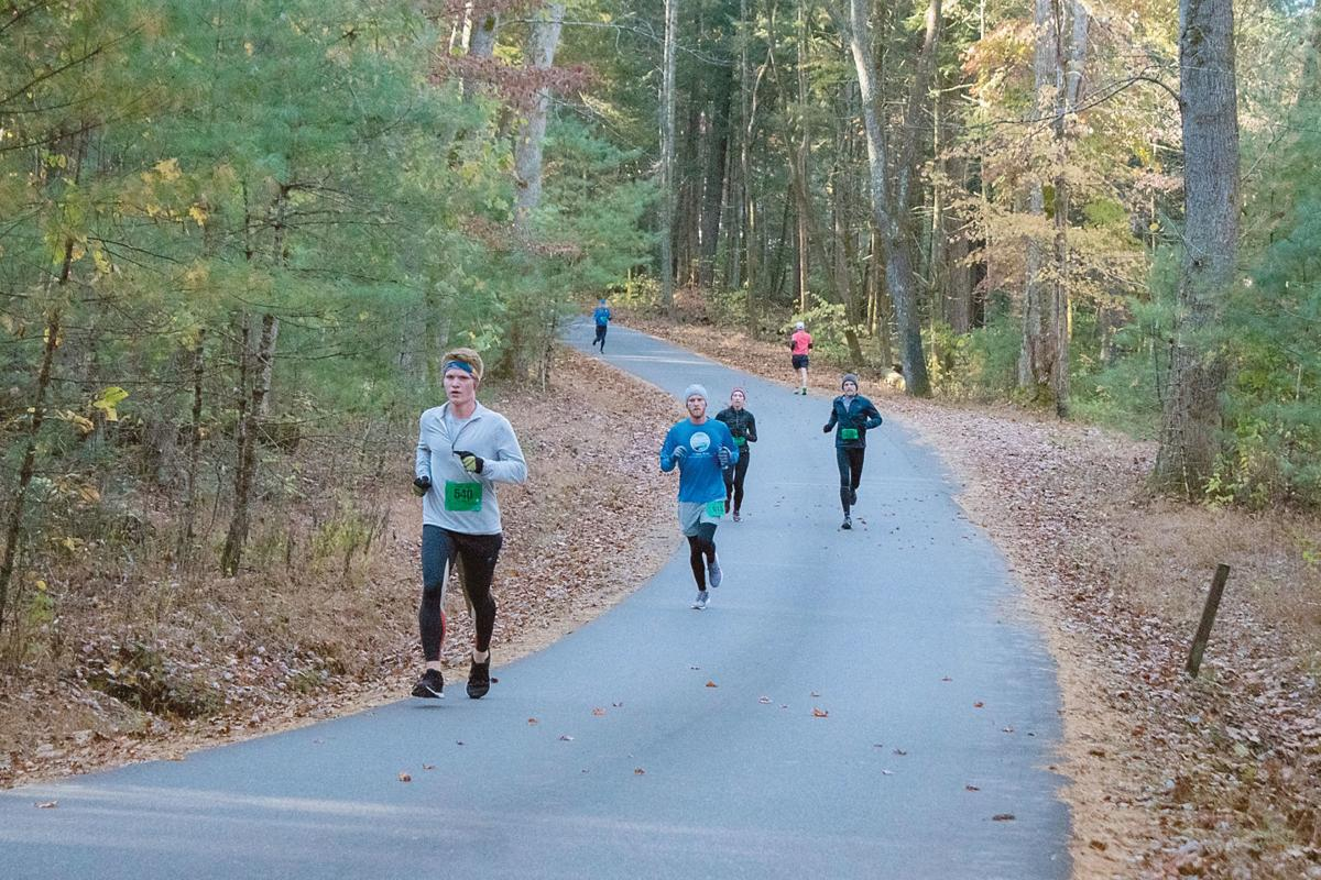 Runners run in the Cades Cove Lope