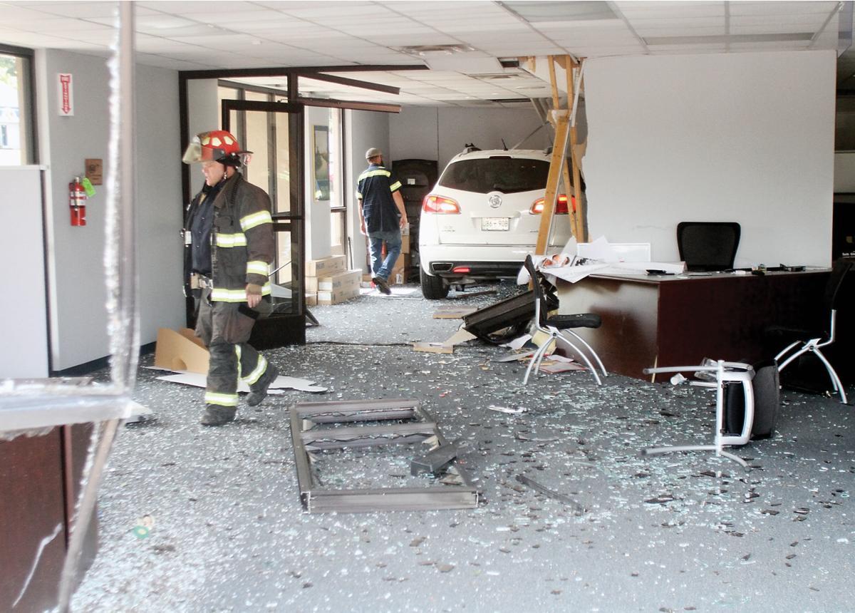 An automobile ran through the AAA Building