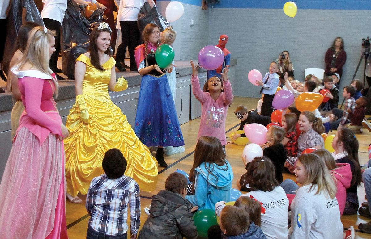 Children play with balloons and with princesses on Adoption Day