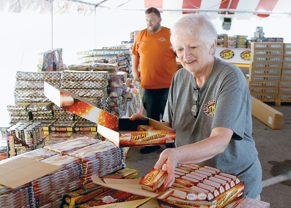 Paulette Jenkins and her son Jonathan Reneau set up stacks of fireworks