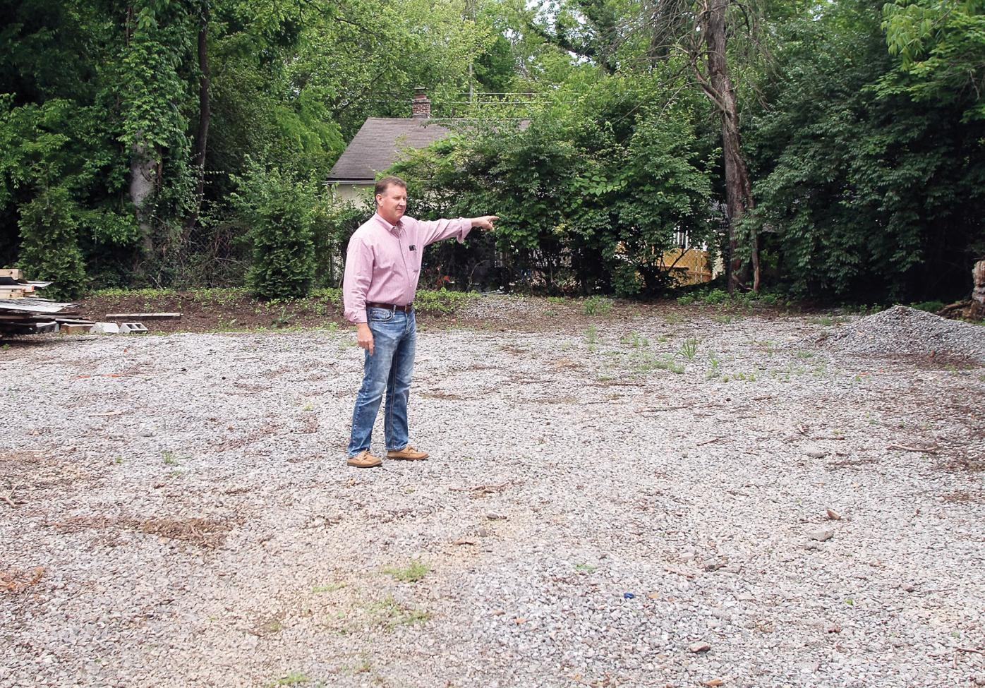 Jay Blevins shows potential site for cell phone tower