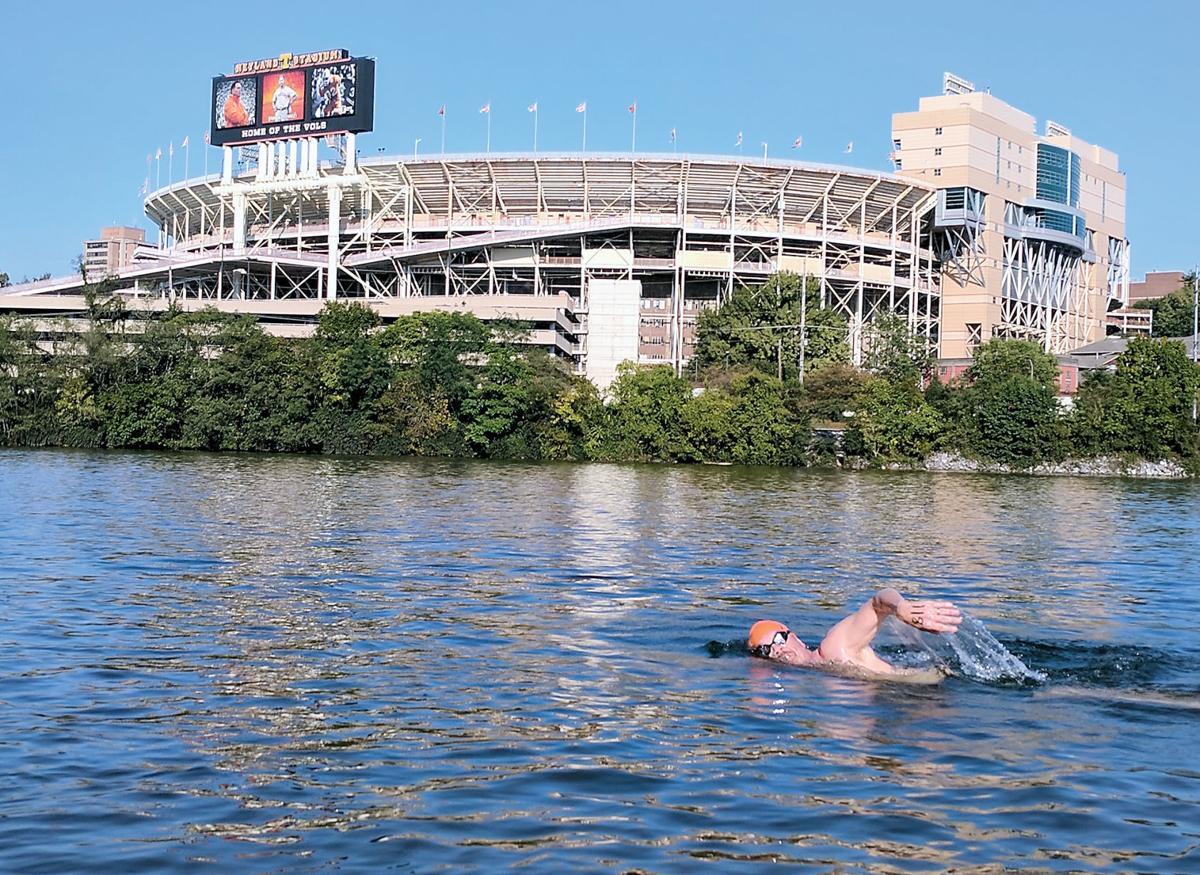 Phil Colclough open water swimming past Neyland Stadium
