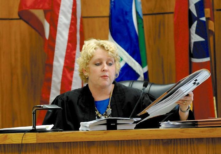 Judge Tammy Harrington with documents in Wheelon case