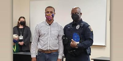 Local pastor honors PG Officer for serving students