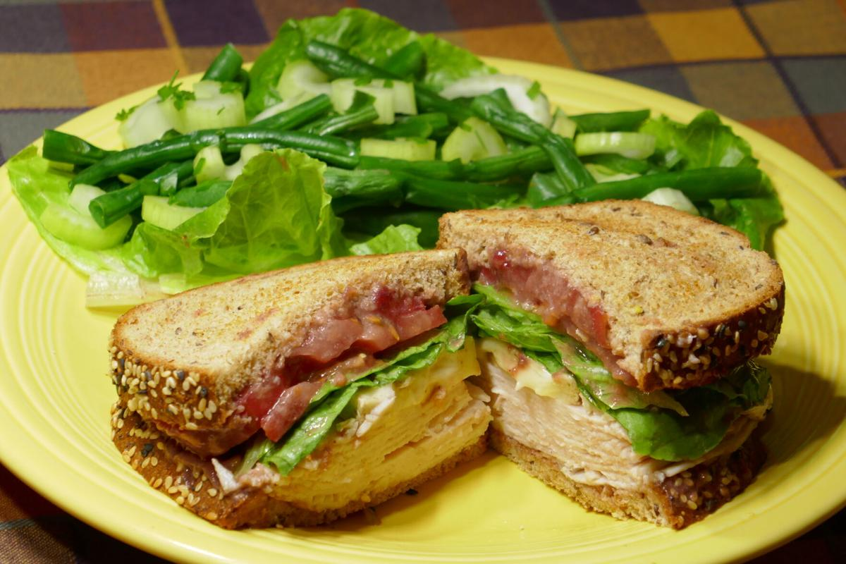 Toasted Turkey and Cranberry Sandwich with Green Bean Salad.