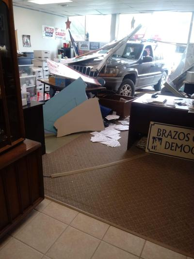 Police: Vehicle drove into office building in Downtown Bryan