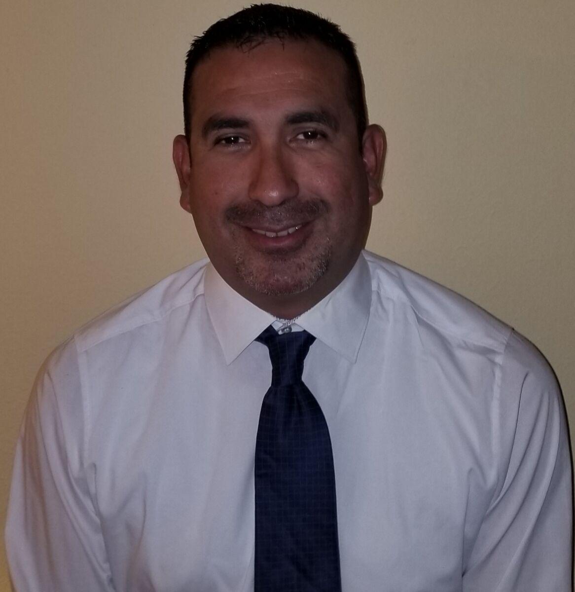 Enrique Luna- Head Coach