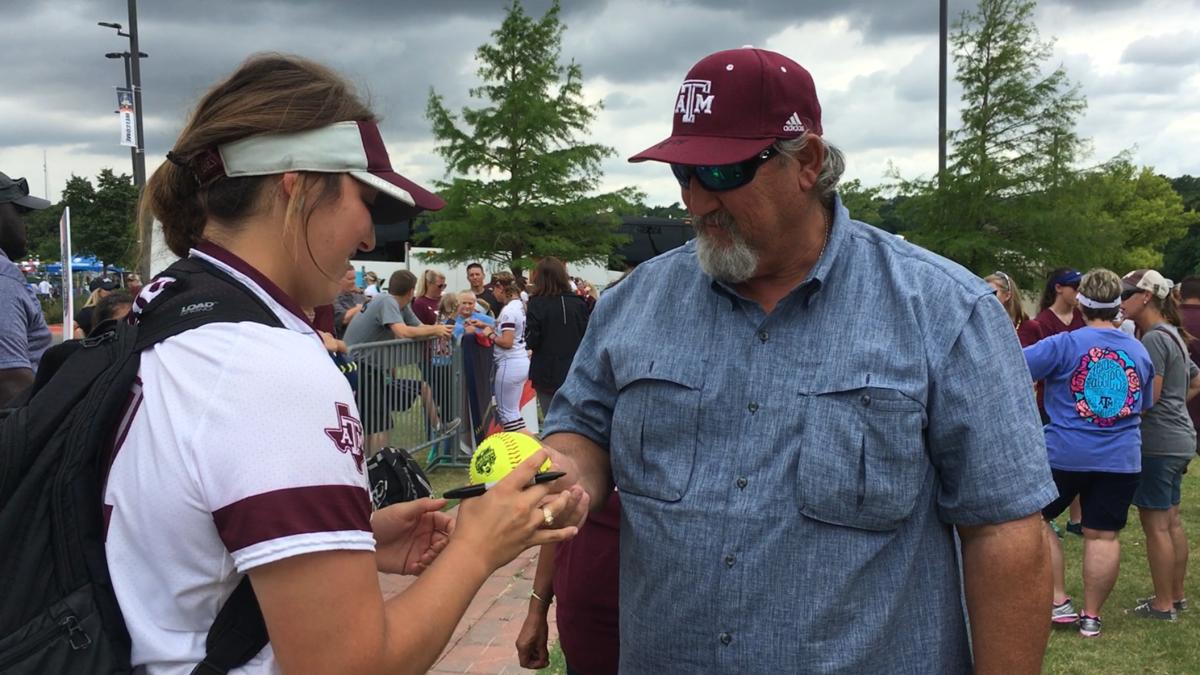A&M senior Celena Massey receives WCWS home run ball from father